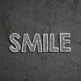 词& x22; Smile& x22;写在黑板 库存例证