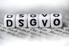 词DSGVO由在报纸abbrevation的木字母表块形成了德国法律的 免版税库存图片