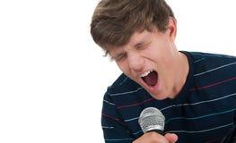 话筒唱歌的少年 免版税图库摄影