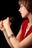 话筒歌唱家年轻人 库存图片