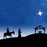 诞生与星形的耶稣诞生在蓝色晚上场面 免版税库存照片