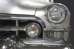 详述一辆老葡萄酒汽车的前面车灯 免版税库存照片