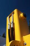 详细资料液压线橙色雨拖拉机 库存图片