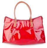 诱饵 在背景的红色提包袋子 库存图片