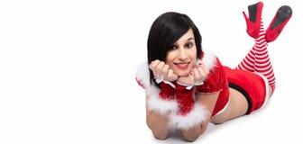说谎在地板上的美丽的圣诞老人妇女 免版税图库摄影