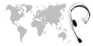 请与全球性概念、顶视图耳机和地图联系 库存图片