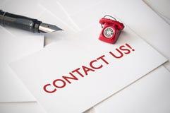 请与邮件联系给我们打电话 库存照片