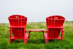 请坐这里 为双放松 库存照片