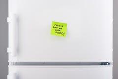 请感觉我与关于绿色稠粘的纸的食物笔记 免版税图库摄影