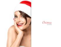 请求圣诞老人妇女 圣诞老人帽子的秀丽式样女孩 库存图片