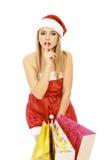 请求女性圣诞老人购物 免版税图库摄影