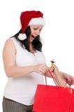请求怀孕的购物妇女 免版税图库摄影