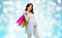 请求愉快的怀孕的购物妇女 库存照片