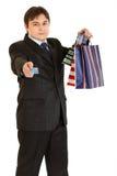 请求生意人产生购物的看板卡赊帐 免版税图库摄影