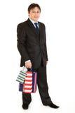 请求生意人藏品购物微笑的年轻人 免版税库存图片