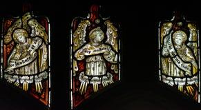 诸圣日教会彩色玻璃南墙壁网眼图案点燃B 库存照片