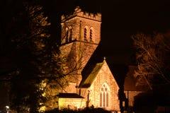 诸圣日教会探照灯照明在晚上 库存图片