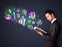 读与企业象的年轻人一本书 免版税库存图片