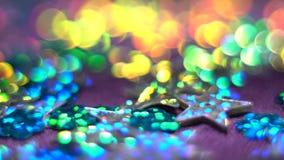 调低银色闪亮的星 与bokeh的抽象发光的背景 圣诞节或假日题材 HD 影视素材