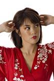 调整头发妇女 免版税图库摄影