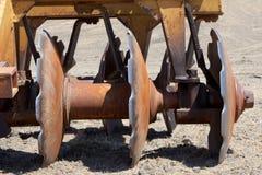 调节剂弯曲的光盘责任大量土壤 免版税库存照片
