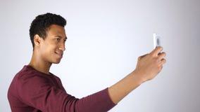 谈美国黑人的人与智能手机的Selfie,拍照片 免版税库存图片