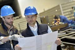 谈论工业的人民prodution质量 免版税图库摄影