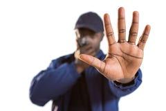 谈话在携带无线电话和做手中止姿态的确信的安全 免版税库存图片
