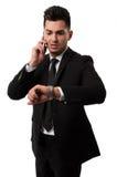 谈话在电话和看的商人喂 免版税库存照片