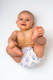 说谎在后面的可爱的女婴隔绝在白色 免版税图库摄影