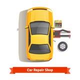 说谎在汽车下的汽车修理师完成修理工作 免版税库存照片