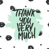 谢谢-在圆点背景的手拉的字法词组 乐趣刷子墨水题字为 库存照片