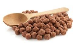 谷物在白色的巧克力球 免版税库存图片