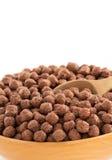 谷物在白色的巧克力球 免版税库存照片
