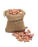 豆粗麻布红色大袋溢出 免版税图库摄影
