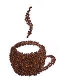 豆被塑造的咖啡杯 免版税库存照片