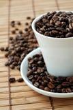 豆coffe杯子 免版税库存照片