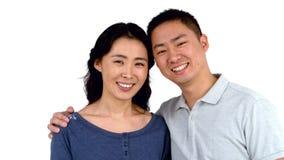 画象亚洲微笑的夫妇摆在 影视素材