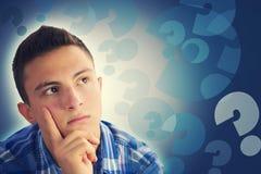 画象英俊十几岁的男孩认为 库存图片