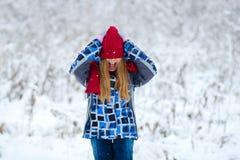 画象青少年的女孩在冬天森林里 免版税图库摄影