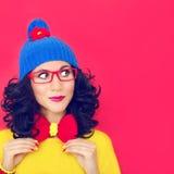 画象绯红色背景的一个女孩 图库摄影
