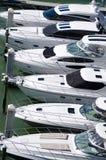 豪华游艇行在小游艇船坞船坞的 免版税库存图片