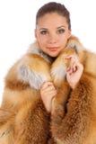 豪华皮大衣的少妇 免版税库存照片