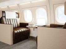 豪华私人喷气式飞机照片内部  空的皮椅,现代普通设计膝上型计算机桌 准备好空白的白色的屏幕 库存图片