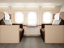 豪华私有飞机照片内部  空的皮椅,现代普通设计膝上型计算机桌 图象准备好您 库存图片