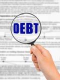 负债玻璃现有量扩大化的字 免版税库存照片