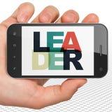 财务概念:拿着有领导的手智能手机在显示 免版税库存照片