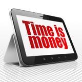 财务概念:有时间的片剂计算机是在显示的金钱 免版税库存图片