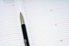 财务笔计划程序用工具加工每星期 免版税库存图片