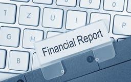 财政报告-与文本的文件夹在键盘 库存图片